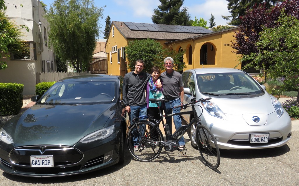 That's our family with with our two plug-in cars and e-bike fueled from the sun. Plates: GAS R.I.P & COAL BAD.